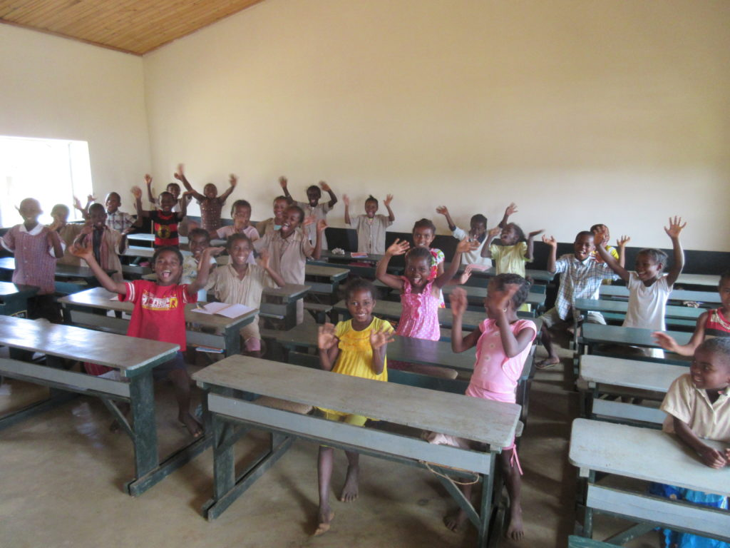More students in another new classroom, certainly a big improvement.